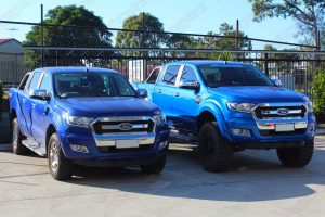 A Ford Ranger with factory suspension next to the Ford Ranger with a 5 inch lift kit at the front of the Superior 4wd retail store in Brisbane