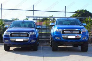 A Ford Ranger with factory suspension next to the Ford Ranger with a 5 inch lift kit at the front of the Superior 4wd retail store in Brisbane - Full Front View