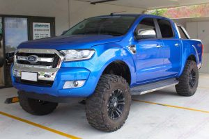 "Front left side view of the current model Ford Ranger (PX11) after being fitted with a 5"" inch lift kit at the front of the Superior 4x4 retail showroom"