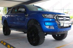 """Front right side view of a Ford Ranger (PX11) after being fitted with a 5"""" inch lift kit at the front of the Superior 4x4 retail showroom"""