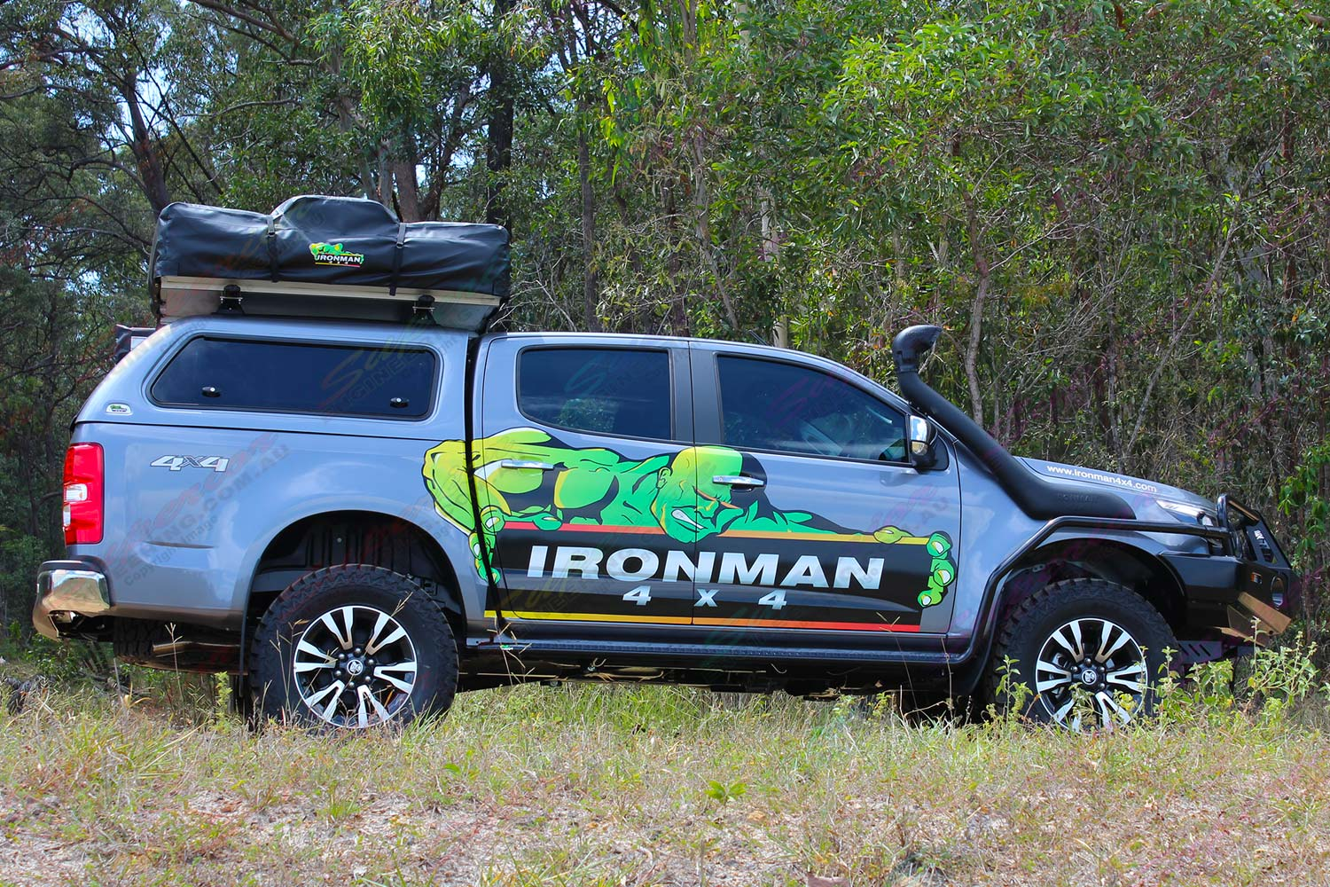 Right side view of a RG Holden Colorado dual cab fitted out with a complete range of Ironman 4x4 accessories and camping gear