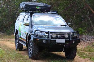 Front view of an Ironman bullbar, driving lights, snorkel, side steps, rails, roof tent and canopy fitted to the RG Holden Colorado four wheel drive vehicle