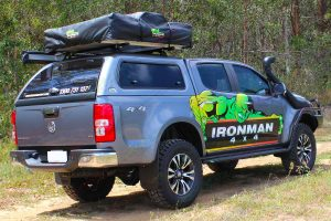 Rear right end view of the RG Holden Colorado (dual cab) fitted out with a complete range of Ironman 4x4 accessories and camping gear