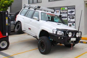 Testing out the flex of the Nissan Patrol Wagon with the forklift lifting up the rear end - out at the side of the Deception Bay 4WD Retail Store