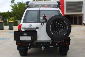 Rear end view of the Nissan Patrol fitted with MCC4x4 Rear bar with wheel carrier and dual jerry can carrier