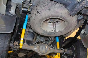 Closeup underside view of a set of Bilstein shock absorbers, leaf springs and shackles fitted to the rear of the Toyota Hilux Vigo