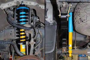 Closeup underside view of a Bilstein shock absorber, leaf spring and shackle fitted to the rear of the Toyota Hilux Vigo and strut with coils fitted to the front