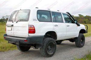 Rear right end view of a white 105 Series Toyota Landcruiser Wagon after being fitted with a 3 inch Superflex Tough Dog 4x4 lift kit