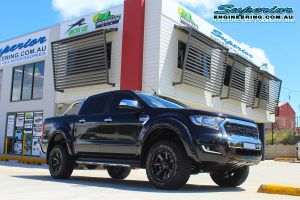 Front right view of a black PX Ford Ranger (Dual Cab) fitted with a 40mm Ironman 4x4 lift kit out the front of the Deception Bay 4WD showroom