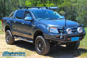 Front right view of a dark grey Ford PX Ranger after being fitted with a 2 inch Bilstein and EFS Lift Kit by Superior Engineering