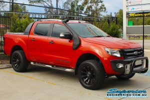 Front right view of an orange WildTrack Ford Ranger at the Deception Bay 4x4 Retail Store fitted with a set of light duty Dobinsons coil springs