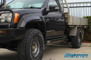 Left side closeup view of a Black Single Cab RC Holden Colorado showing off the heavy duty Superior Stealth rock sliders