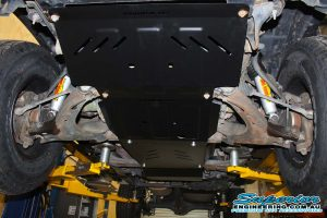 Closeup under vehicle view of the Ironman 4x4 Engine Bay and Transmission Guard fitted to the Holden Colorado single cab ute while on the hoist at Superior Engineering