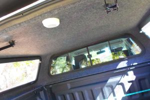 Full interior view of the Ironman Ute Canopy showing the hard wearing brush carpet and Internal quickfit system and clamps