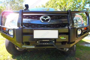 Low profile closeup view of the Ironman 4x4 Black Deluxe Commercial Bullbar fitted to the front of the Mazda BT50