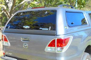 A Silver Ironman 4x4 thermoplas canopy fitted to the rear style side tray of the Mazda BT-50 Dual Cab ute