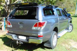 Rear end view of the Mazda BT-50 fitted with the Ironman Ute Canopy with all the canopy windows open