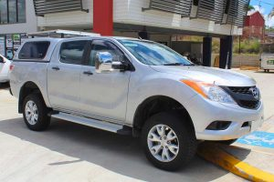 Front right view of a silver dual cab Mazda BT-50 4x4 after being fitted with a 2 inch Ironman and Superior lift kit at the Superior Engineering Deception Bay showroom