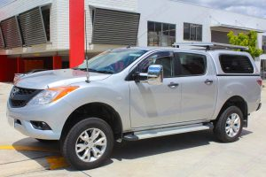Front left view of the Mazda BT-50 after being fitted with a 2 inch Ironman and Superior lift kit in the car park at the Superior Engineering Deception Bay showroom