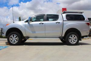 Left side view of the Mazda BT-50 in the car park at the Superior Engineering Deception Bay showroom after being fitted with the 2 inch lift kit