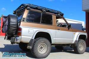Right side view of a short wheel base GQ Nissan Patrol fitted with a 3 inch Superior Remote Reservoir Hybrid Superflex Lift Kit and other Superior 4x4 accessories