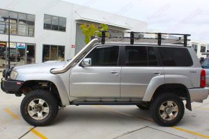Left side view of a silver GU Nissan Patrol Wagon at the Deception Bay 4x4 retail store after being fitted with a 4 inch Superior Remote Reservoir Drop Box Lift Kit