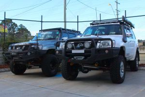 Side by side comparison of 2 lifted Nissan Patrol GU wagons - one with a 3 inch lift and the other with a 4 inch lift