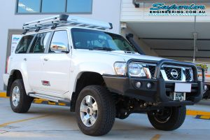 Front right view of a white GU Nissan Patrol wagon after installing a 2 Inch Superior Remote Reservoir Lift Kit and coil tower brace kit at the Deception Bay 4x4 Super Showroom