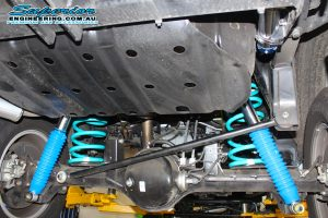 Closeup view of a pair of Superior Remote Reservoir shocks and Dobinson coil springs fitted to the GU Nissan Patrol Wagon
