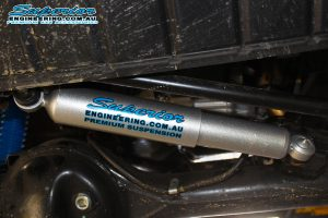 Closeup view of a single Superior nitro gas steering damper fitted to the front of the GU Nissan Patrol Wagon
