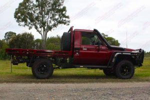 Right side view of a Maroon 79 Series Toyota Landcruiser (Single Cab) at Superior Engineering fitted out with a new rear coil conversion kit