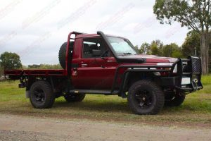 Right side view of a Maroon 79 Series Toyota Landcruiser (Single Cab) fitted out with a new rear coil conversion kit
