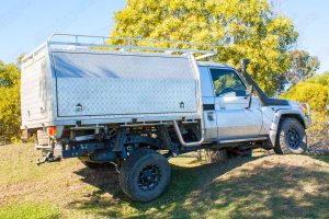 Right side view of a Silver 79 Series Single Cab Toyota Landcruiser at the Superior Engineering workshop fitted out with a new rear coil conversion kit, front suspension and airbag kit