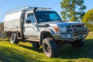 Front view of the Silver 79 Series Toyota Landcruiser (Single Cab) testing out the flex and suspension at the Superior Engineering workshop after being fitted with a rear coil conversion kit, front suspension and airbag kit