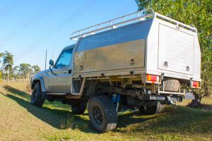 Rear left side view of the Silver 79 Series Toyota Landcruiser (Single Cab) testing out the flex and suspension after being fitted with a Superior coil conversion kit
