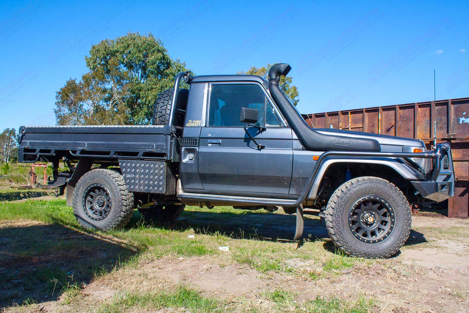 Right side view of a Grey 79 Series Single Cab Toyota Landcruiser at Superior Engineering fitted out with a new rear coil conversion kit and front suspension parts