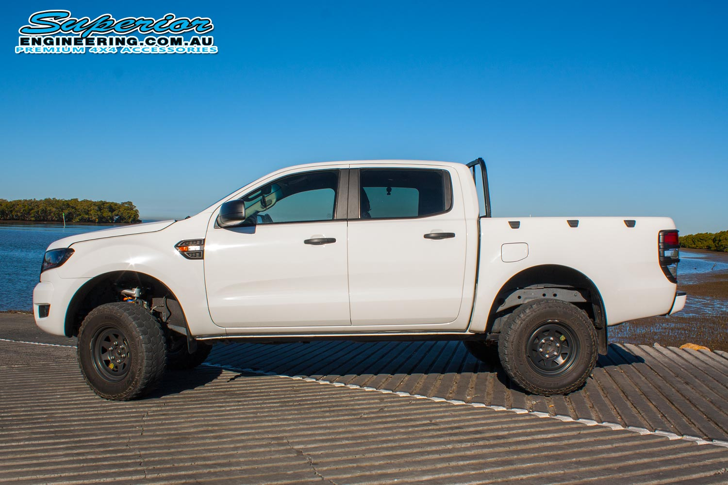 Left side view of a white Ford Ranger PX after being fitted with a 3 inch Superior Nitro Gas lift kit at the Superior Engineering Burpengary workshop