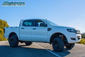 Right side view of a white Ford Ranger PX dual cab after fitted with a 3 inch Superior Nitro Gas lift kit at the Superior Engineering Burpengary workshop