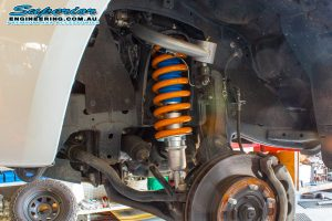 Closeup view of a single Superior Nitro Gas strut, coil spring and upper control arm fitted to the front of a PX Ford Ranger (dual cab) at the Superior Engineering Burpengary workshop