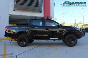 Right side view of a black Mitsubishi MQ Triton fitted with a 40mm Bilstein lift kit and Ironman 4x4 Accessories