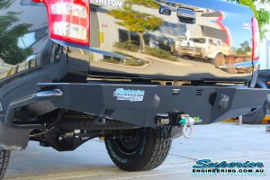 Rear end view of a MQ Mitsubishi Triton dual cab fitted with an Ironman 4x4 rear protection tow bar and recovery hitch with a bow shackle