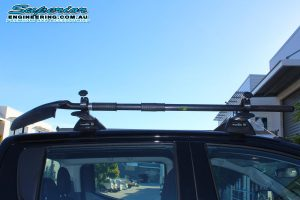 Closeup view of a Whispbar roof rack and shovel holder and Ironman shovel mounted on the roof of a MQ Mitsubishi Triton 4wd