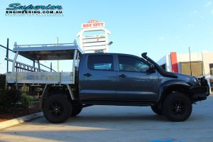 Right side view of a dual cab Toyota Hilux fitted with a complete range of 4x4 accessories and 3 inch lift kit