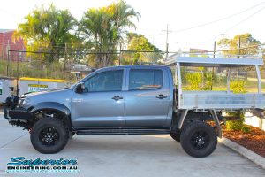 Left side view of a grey dual cab Toyota Hilux fitted with a complete range of 4x4 accessories and 3 inch Superior Adjustable Monotube Remote Reservoir lift kit at the Superior Deception Bay 4WD Showroom
