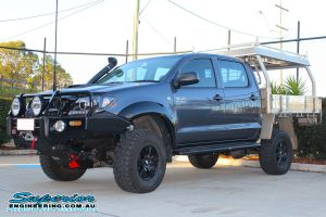 Front left view of a grey dual cab Toyota Hilux fitted with a complete range of 4x4 accessories and 3 inch Superior Adjustable Monotube Remote Reservoir lift kit at the Superior Deception Bay 4WD Showroom