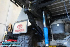 Closeup view of a Superior remote res shocks and efs leaf spring fitted to the rear of the dual cab Toyota Hilux