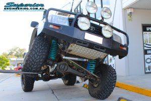 Flexing the front driver side of the 105 Series Toyota Landcruiser after being fitted with the huge 6 inch superflex lift kit at the Superior Engineering 4x4 Retail store