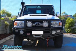 Front view of the 76 Series Toyota Landcruiser wagon after being fitted with a Superior radiator and engine guard