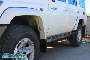 Closeup left side view a single Superior Stealth Rock Slider fitted to the side of a 76 Series Toyota Landcruiser four wheel drive