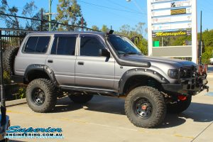 Right side view of a 80 Series Toyota Landcruiser fitted with a set of Dobinsons coil springs out the front of the Deception Bay 4wd retail store